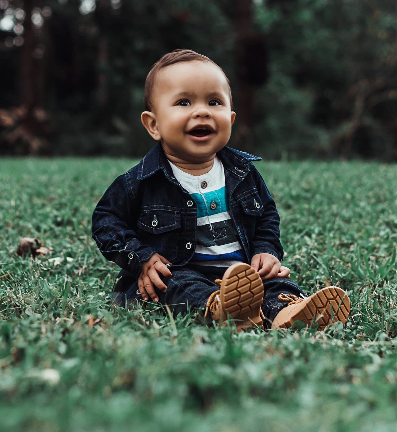 photo-of-smiling-baby-boy-in-denim-outfit-sitting-on-grass-2760338-e1593718189259.jpg